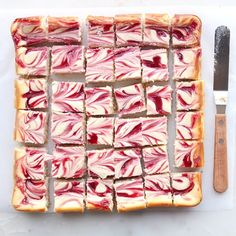 These White Chocolate Raspberry Cheesecake Bars are almost too pretty to eat... almost.