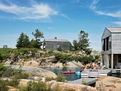 On the edge of a tiny island accessible only by boat, this buoyant summer home lives the life aquatic.