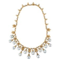 Spectacular Buccellati necklace in 18k yellow gold. It features cultured baroque pearls ranging from 10-12mm, and 11.00 carats total weight of Dutch rose cut diamonds.
