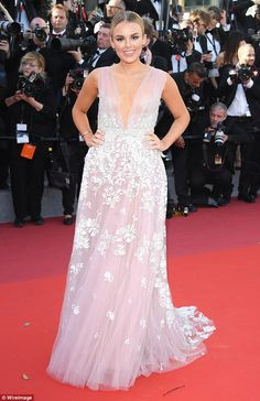 Think pink: Before that, she wore a show-stopping pastel pink gown, embroidered with delic...