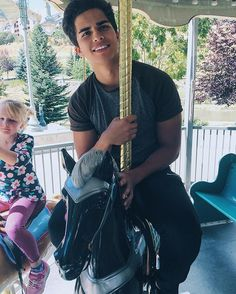 """""""Just me, sitting next to a little girl, riding a carousel."""""""