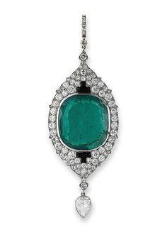 A RARE INDIAN INFLUENCED ART DECO EMERALD AND DIAMOND PENDANT, BY CARTIER  The cushion-shaped emerald to the circular-cut diamond-set plaque with onyx detail suspending a pear-shaped diamond drop, French, 1921, 8.6 cm long, in fitted black leather case  Signed Cartier no C7250