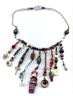 Found objects necklace --- love the way the objects dangle from beaded elements --- really cool!