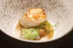 Hokkaido Scallop seared to perfection, accompanied by peas coated in white pork lard. Chef Benjamin Halat's new menu at CURATE is nothing short of amazing.