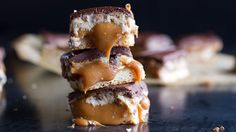 A baked cookie base and layers of creamy caramel, almond cookie dough, and a chocolate-peanut butter top.