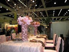 Wrap some of the tall vases in patterned fabric that coordinates with colors...great idea!