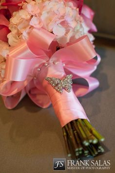 Butterfly brooch accent on bride's bouquet. A great way to accent the butterfly wedding theme.
