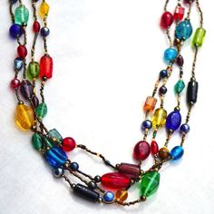 Beautiful multi-strand vintage necklace made from lots of pristine colorful glass beads (some beads are glazed, some are shiny and translucent) and s...  #beads #black #blue #green #orange #rainbow #red #yellow #vintage #jewelry