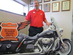 """Doug Hauschild of Beavercreek not only made his milestone 110th lifetime donation with his apheresis appontment today at the Dayton CBC... he also was autmatically entered into the """"King of the Road Blood Drive"""" drawing to win a Harley Davidson Road King Classic motorcycle. (Is that the actual Road King Doug is standing behind...?)"""