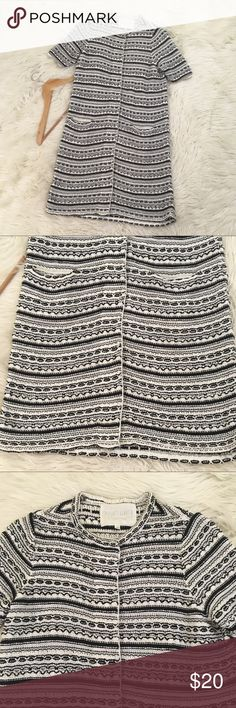 """Rachel Roy Womens Sz M Long Retro Cardigan/Dress * Has a Retro look to it!   • Black and White  • Striped patterns  • Short Sleeve  • Knit  • Huge snaps  • Excellent condition no flaws  Length: 35""""  Armpit to armpit: 19""""  📌NO lowball offers 📌NO modeling 📌NO trades  Come check out the rest of my closet! I have various brands and ALL different sizes! Rachel Roy Dresses"""