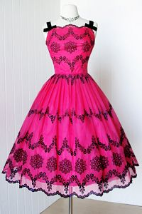 1950's cocktail dress. Sheer layer with black pattern over a bright fuchsia fabric