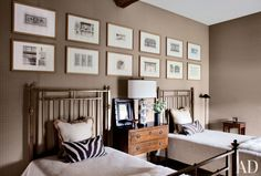 A bedroom by Jean-Louis Deniot features a series of architectural prints.