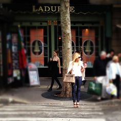 skinny jeans, Chanel jacket, Hermes Kelly while eating a giant pink Laduree macaron   in Paris...ooh la la perfection!