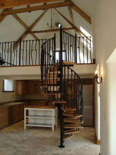 Excellent Picture Of Home Interior Decoration Using Various Indoor Spiral Staircase : Beautiful Picture Of Home Interior Decoration Using Wooden Metal Indoor Spiral Staircase Including Black Metal Staircase Railing And Floating Light Oak Wood Staircase Step