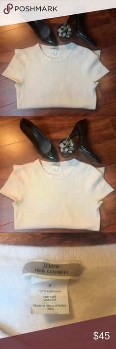 """J Crew Italian Cashmere Tee Shirt Size Small J Crew Italian Cashmere Tee Shirt Size Small!  Creamy white.  Cap sleeves.  Two small marks (last photo) that I did not know where there until I started photographing so take that as an indicator of how subtle they are 🤷🏼♀️   15.5"""" across chest 24"""" shoulder to hem 100% Cashmere Made in China of Italian yarn J. Crew Tops"""