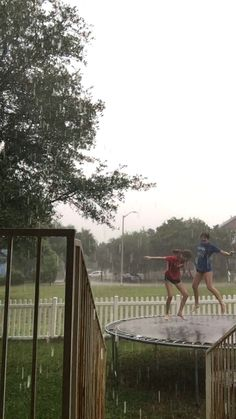 besties jumping in the rain