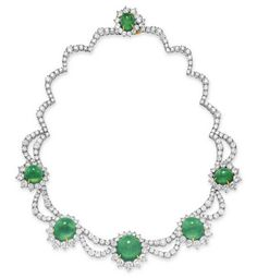 AN EMERALD AND DIAMOND NECKLACE   Set with a graduated series of five cabochon emeralds, each within a circular-cut diamond surround, spaced by circular-cut diamond swags, to the circular-cut diamond scalloped backchain and cabochon emerald clasp, mounted in platinum and 18k gold, 16 ins.