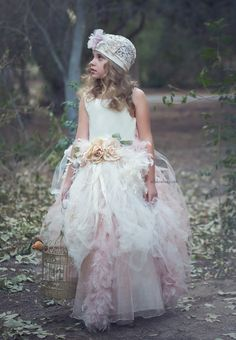 ALALOSHA: VOGUE ENFANTS: Far above the clouds with this stunning feather tutu dress from Elena Pulido