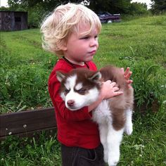 sadfk;ljasf  I know their kid is younger when the puppy is a baby. But this would totally be their son just all CARRYIN' MY PUP.