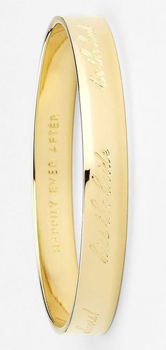 Love the cursive inscription on this pretty gold Kate Spade bracelet.