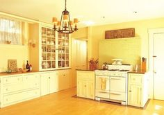 Beautiful bright kitchen. I love the buttery colored walls with white cabinets.