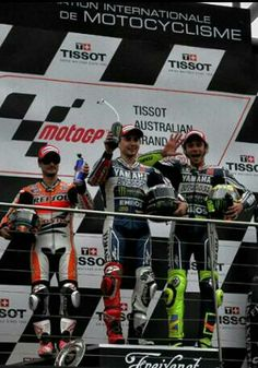 Rossi 3rd, pedrosa 2nd, lorenzo 1st at phillip island 2013. Very dramatic race, marquez disqualified, mandatory bike change for all riders, only 13 laps..