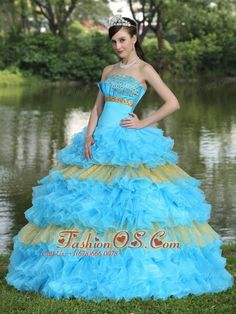 Beaded Decorate Bust Sequins Organza Aqua Blue and Yellow Strapless Floor-length Tiered Sweet Quinceanera Dress For 2013  http://www.fashionos.com  There're just something about vintage-inspired gowns that no other style can duplicate. They evoke a certain charm that you just can't find in the newer styles. This one puts you to mind of a traditional southern belle. It features a lovely strapless bodice that's embellished with gold beadings and lines on the bust.
