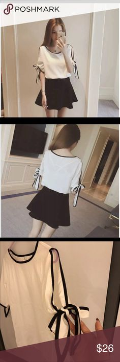 White/black split sleeve bow blouse White & black, NEW never worn. Size small but will fit XS- a tight medium. Feel free to ask any questions.  SAME/NEXT DAY SHIPPING Urban Outfitters Tops Blouses