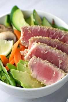 Sesame crusted ahi tuna with soy ginger sauce - a healthy and very simple dish to make! Pickled cucumbers add a sweet and tangy crunch with each bite. | jessicagavin.com
