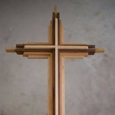 Wooden Cross » 20 inches tall. Three contrasting solid woods are layered to create this cross. The light wood is maple, the medium-toned is american red oak, and the dark is black walnut. DenneheyDesign.com