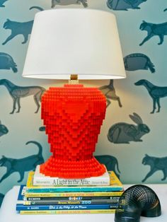 Don't spend a lot on lighting: Learn how to repurpose old household items into new lamps, pendants and chandeliers.