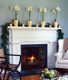 An Understated Mantel - For an elegant look, trim the mantel with a row of white votives and dramatic white amaryllises. Amaryllis bulbs can be repotted and forced to bloom again next winter. Fireplace Molding, Fireplace Redo, Fireplace Design, Fireplace Ideas, Simple Fireplace, White Fireplace, Faux Fireplace, Christmas Mantels, Cottage