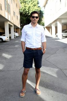 Bermuda shorts and white button-down. Classic summer look.