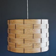 Saw this diy-ed here: http://ourhumbleabowed.wordpress.com/2011/08/24/woven-wood-pendant/ - I could totally do this.