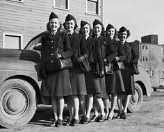 Women drivers of the United States Army Signal Corps stand for a portrait. (Left to right, Mrs. Jensen, Mrs. Rhodes, Mrs. Teague, Mrs. Cleminger, Mrs. Savage and Mrs. Philips) ~