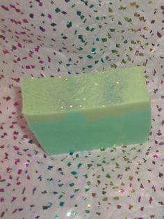 Handmade Cucumber Melon and Avocado bar soap. A light cucumber melon scent.Layered in colors of green and pale yellow/ green. Topped with extra fine sparkly glitter.    One bar of soap, weighing a minimum of 3.5-4 oz. A nice chunky bar of soap.    This soap is handmade with skin loving ingredients of rich and creamy Avocado oil and Cucumber oil.    Each bar is hand cut and because it is hand made and will be unique in its own by size, shape, and color. | Shop this product here…