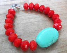 """Beautiful Velvety Strawberry Red Faceted Glass Beads & a Semi-Precious Turquoise Egg Make up This Sweet & Simple Bracelet. Perfect with your Favorite Jeans & T Shirt or a Sweet Summer Sun Dress!    Sterling Silver Toggle Clasp    Length is Approximately 7.5"""" Long  Turquoise Stone is 1 & 1/4"""" Long x 3/4"""" Wide.                      $42.00"""