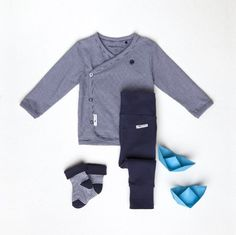Little boys should never be sent to bed. They always wake up a day older. - Peter Pan | Noppies baby collection | #babywear #boyswear #newborn #babyfashion #flatlays #flatlay #babyblue #bluestripes #noppies