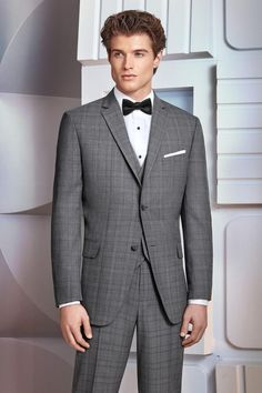 For a modern and updated look, choose the Grey Plaid Hamilton Suit. Tailored in soft, luxurious Super wool, its ultra slim fit styling is made to fit all body types- including big and tall sizes. Slim Fit Suits, Slim Fit Trousers, Tailored Suits, Tuxedo Suit, Tuxedo For Men, Prom Tuxedo, Suit Rental, Fitted Suit, Sharp Dressed Man