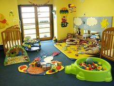 Love this little daycare/playroom set up. Especially the ball pit.