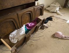 http://abcnews.go.com/Business/photos/photographers-view-americas-foreclosed-homes-17546611/image-American Foreclosure. Clothing is left behind in a dresser and on the floor of a foreclosed home in Fresno, Calif., Feb. 28, 2012. David H. Wells/zReportage/Zuma Press