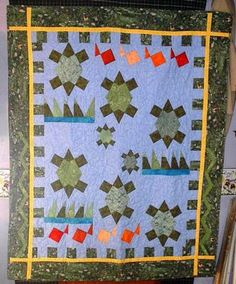 Turtles: I have a friend who collects turtles and I've been wanting to make a quilt for her for a while.  I saw this pattern and the X-blocks templates that went