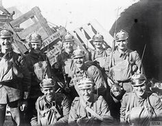 British soldiers with german spiked helmets (pickelhaube) they keep it as a souvenir