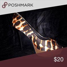 Giraffe Peep-Toe Heels Just fab, 5 inch giraffe print peep toe heels. Great platform making that 5 inch boost a breeze. Excellent condition JustFab Shoes Heels
