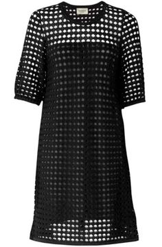 Ivana Helsinki's Janice dress is a game of peekaboo perfected, with glimpses of the arms and shoulders visible through its lace-like dot pattern. This sustainable knitted number is handcrafted from 100 percent Merino wool, so while it may not look the part, it's as warm as can be–an elegant solution for a chilly night out.