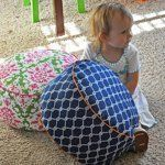 Land of Nod Inspired Floor Cushion (Living with Punks). This supersized pillow tutorial has awesome instructions for using piping.