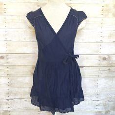 I just added this to my closet on Poshmark: Miss Me navy wrap around blouse Small.  Size: S