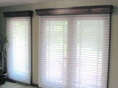 Wood cornices and motorized Window Shadings above French Doors leading out to the patio.