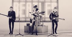 This gif perfectly describes their personalities: Paul - nodding and bowing to the audience- ever the showman. George - frowning for no reason very seriously preoccupied with his guitar. John - goofing around! and Ringo - sitting in the back shyly waving and packing away his drumsticks