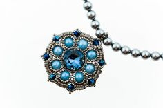 Elegant beaded pendant and necklace with Swarovski Elements, pearls and Japanese seed beads.